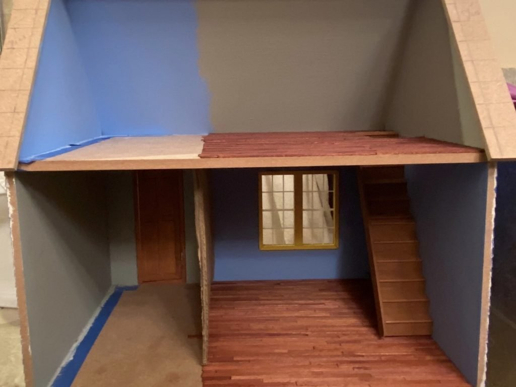A picture of the dollhouse wood floors