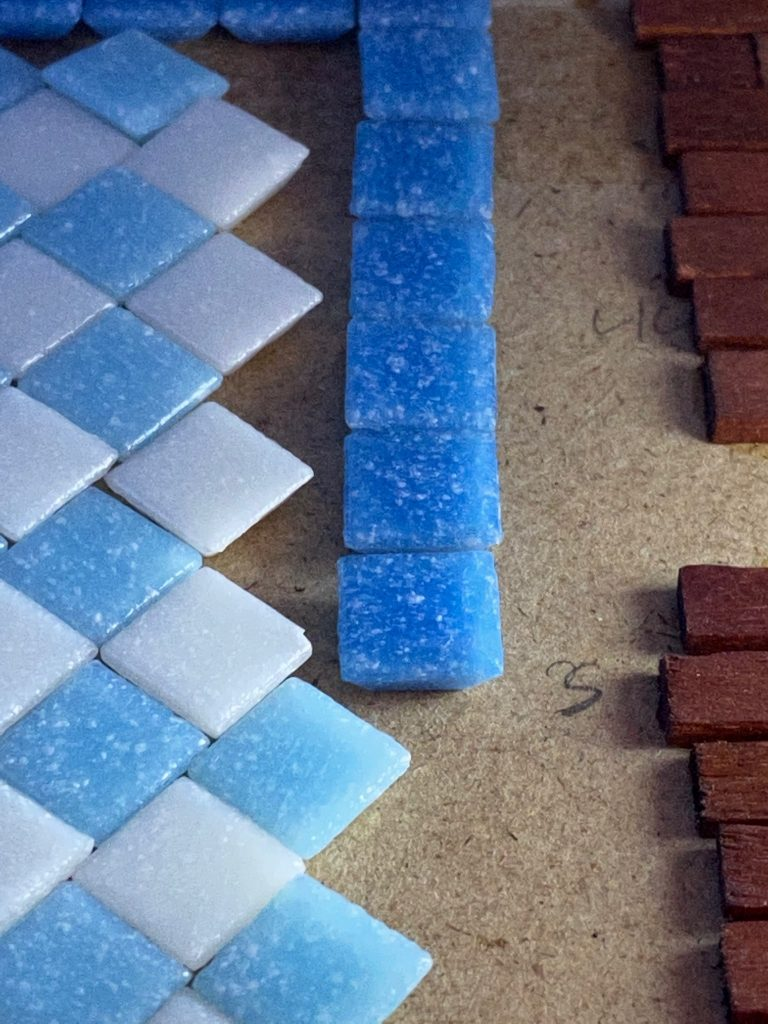 A close up of the border wall with the blue tiles removed