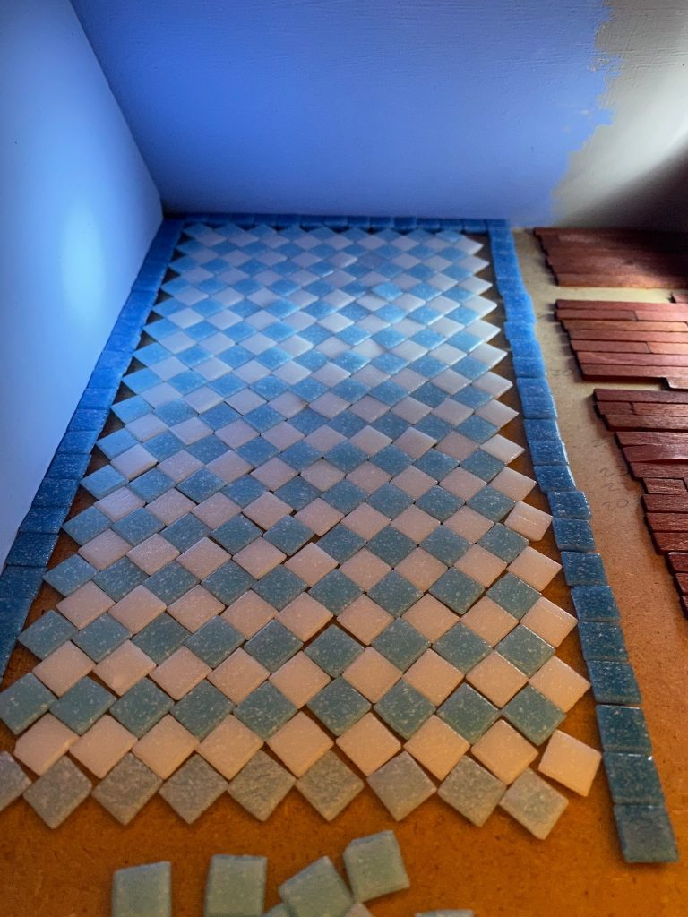The nearly completed floor with the row of blue tiles removed. It fits!