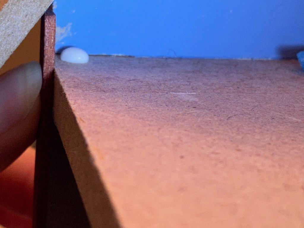 A single drop of Weldbond on the floor