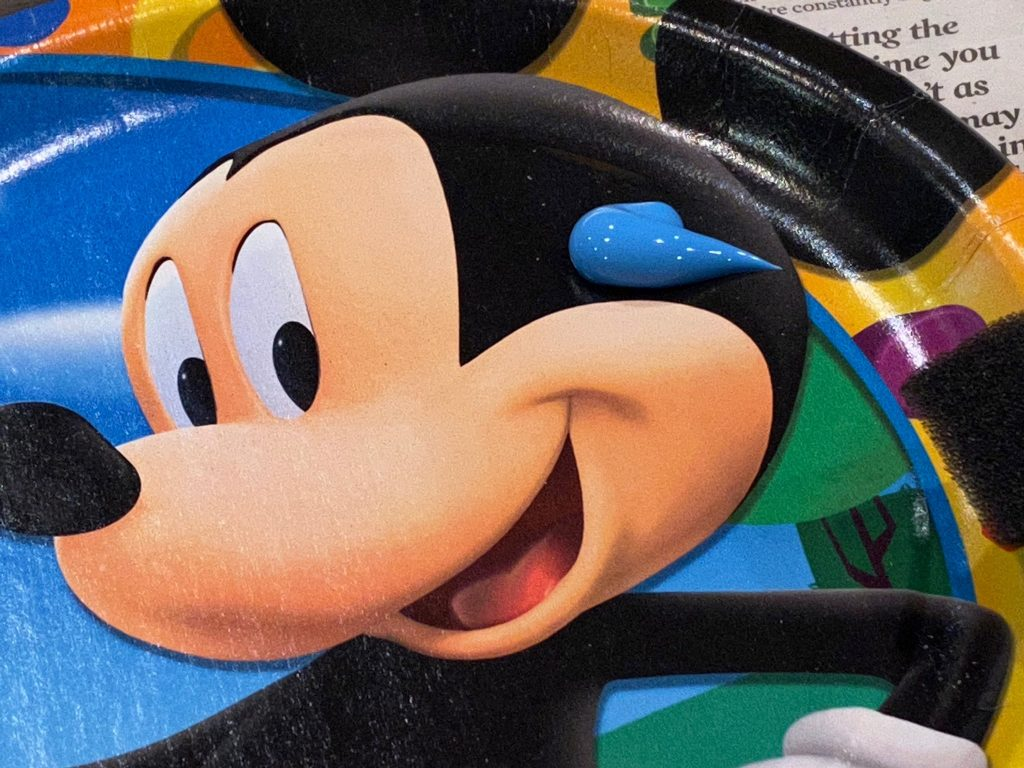 A close up of the blue paint blob on Mickey's head