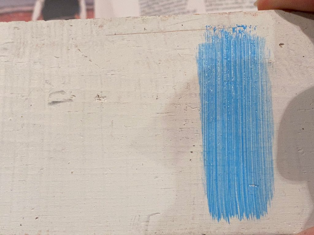 The acrylic paint on the finished side of the wood