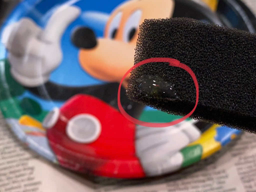 A close up of the acrylic paint extender on the foam brush