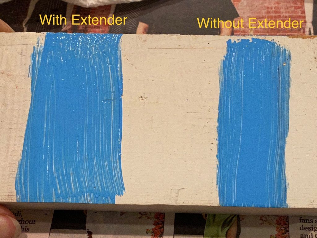 The two paint samples on the wood
