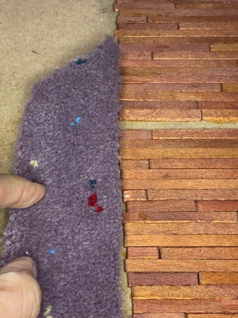 A close up of a carpet remnant as dollhouse carpet flooring