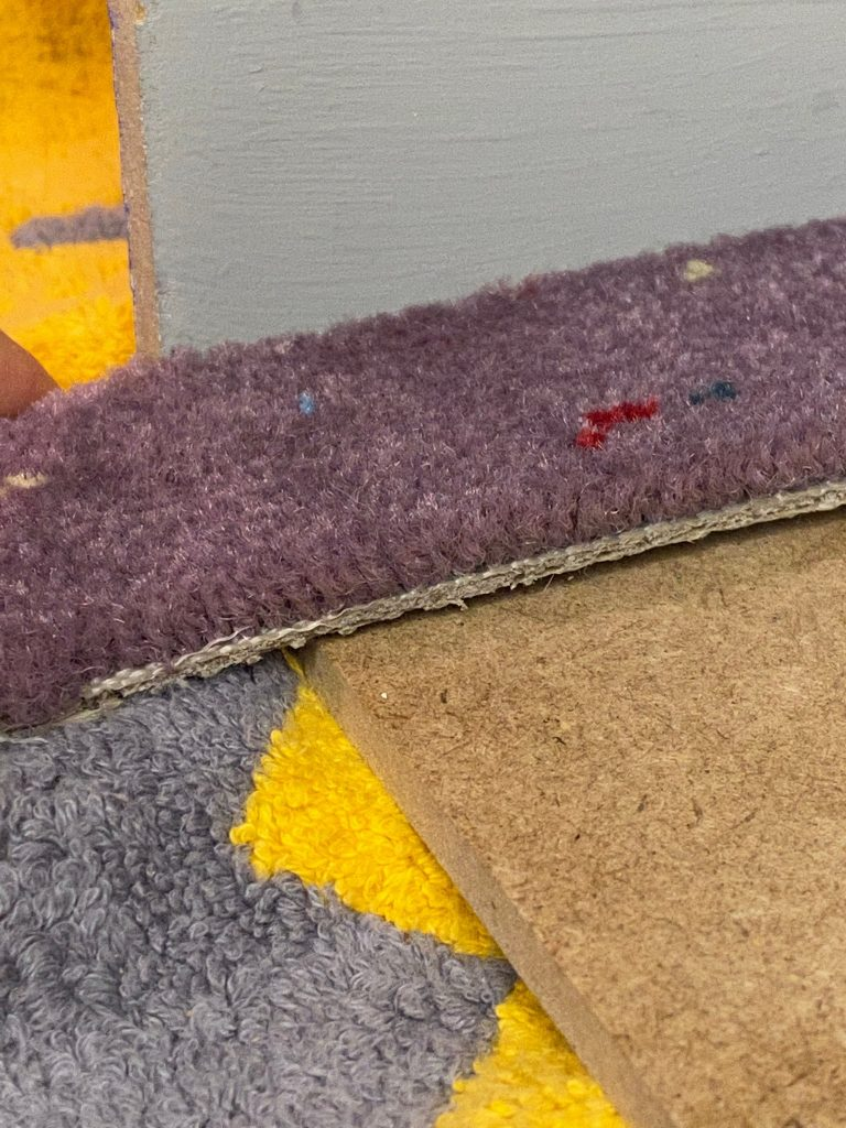 A side view of the carpet remnant dollhouse carpet flooring